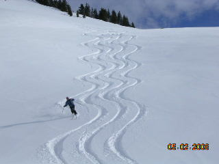 A Ski Addiction guide completing a nice set of tracks